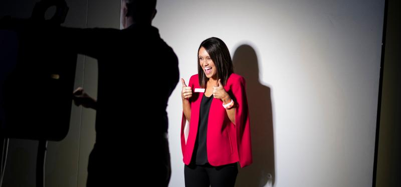 Woman taking a picture at a photo booth at an event